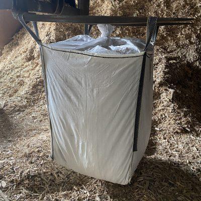 Een Big Bag houtsnippers laten storten